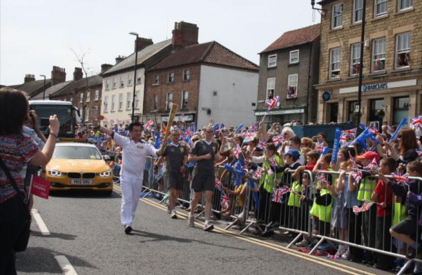 Alan Mak carrying the London2012 Olympic Torch